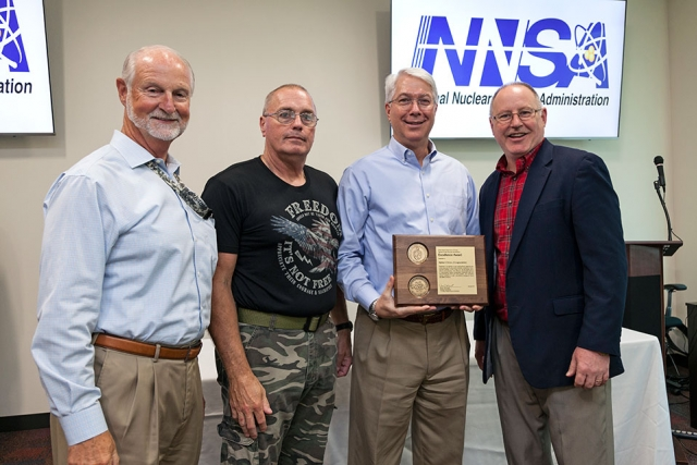 Jim McConnell, National Nuclear Security Administration's Associate Administrator for Safety, Infrastructure and Operations (far right), presents an NA-50 Award of Excellence for Alpha-5 Annex Encapsulation.