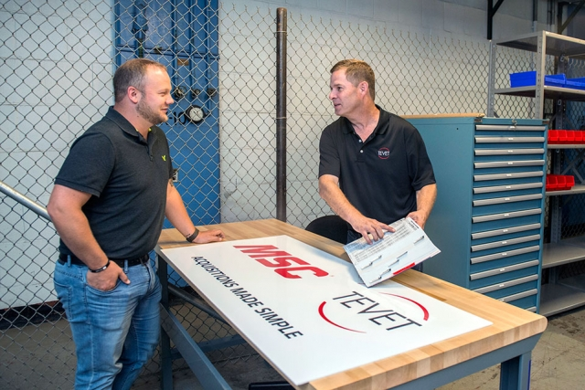 Y-12 Procurement Coordinator Derek Raby, left, and Dennis Lorick of onsite vendor Tevet discuss some of the items that will be available at the new tool crib and parts station.
