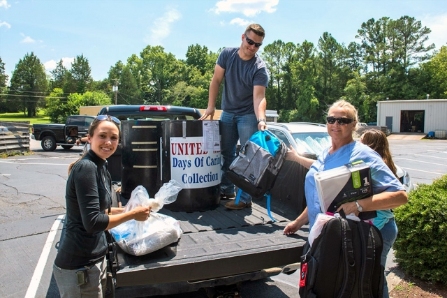 Y-12 employees unload school supplies donated to ADFAC.