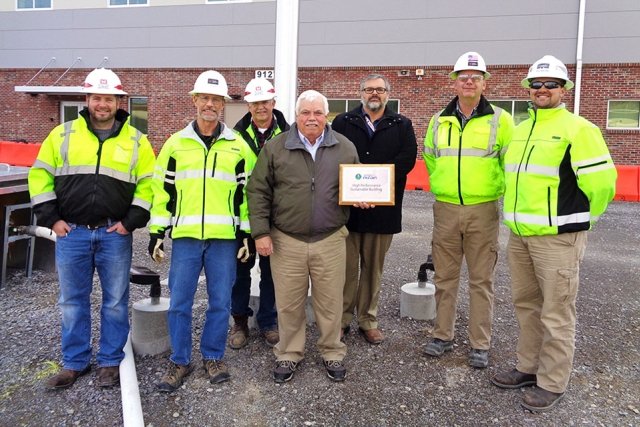 NNSA recently designated UPF's Construction Support Building as a High Performance Sustainable Building. Representatives from the team include (from left to right) UPF Project Office Construction Manager Mike Pearson; UPF Project Office Construction Integrator Halen Philpot; UPF Project Office Field Engineer Bud Slaven; UPF Project Office Site Infrastructure and Services Federal Project Director Don Peters; CNS Energy Manager Charlie Sexton; USACE Resident Engineer Jason Phillips; and USACE PM Forward Joe D