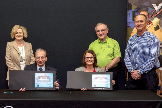Consolidated Nuclear Security, LLC President and CEO Morgan Smith recently signed a mentor-protégé agreement with Cindy Hatfield. CEO of Hatfield Construction. From left, Small Business Program Manager Lisa Copeland and mentors Bill Hevrdeys and Ken Thompson were also present.