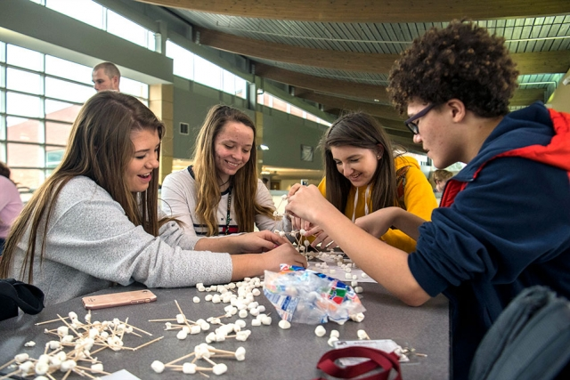 Oak Ridge High School students work together to assemble a tower out of toothpicks and marshmallows after being provided structurally sound designs options. The activity was one of three presented to students as part of Consolidated Nuclear Security's educational outreach during EWeek.