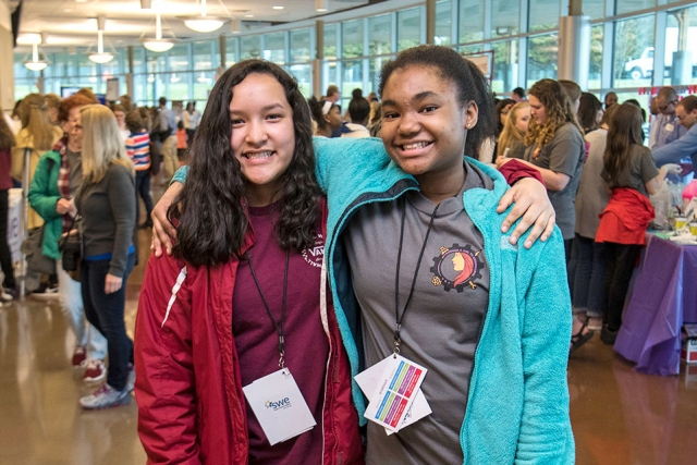 "Cynthia, left, and Jada, both eighth graders at Robertsville Middle School, used communication and critical thinking skills to help their team win one of Introduce a Girl to Engineering's tower challenges. ""If we didn't listen to each other, learn to work together, our tower would collapse,"" Jada said."