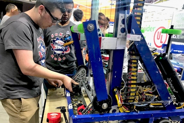 Students from South Doyle High School compete at the TN FIRST Smoky Mountains Regional robotics competition at Thompson Bowling Arena. CNS was a corporate sponsor, providing funds, volunteers, and mentors for the program.