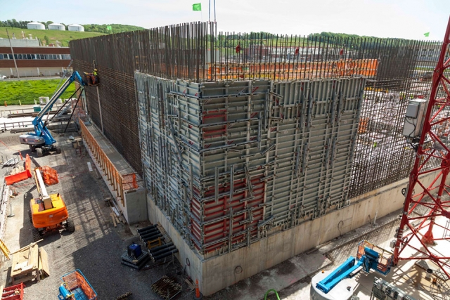 The first vertical wall for the Main Process Building (MPB) has been placed. The wall is 27 feet tall and required 196 cubic yards of concrete.