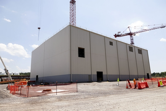 """The Mechanical Electrical Building (MEB) at the Uranium Processing Facility is now """"dried in"""". This milestone includes installation of all siding, doors, roof, and louvers, and completion of underground utility work on the east and north side of the MEB."""