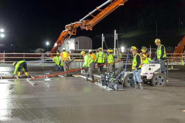 Concrete crews place 885 cubic yards of concrete during a night shift at the Salvage and Accountability Building.