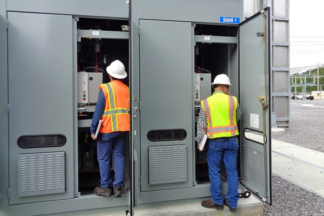 One of two capacitor banks for the Pine Ridge Substation is inspected during a turnover walkdown. The capacitor bank is designed to maintain a stable power supply for the Uranium Processing Facility and the Y-12 National Security Complex.