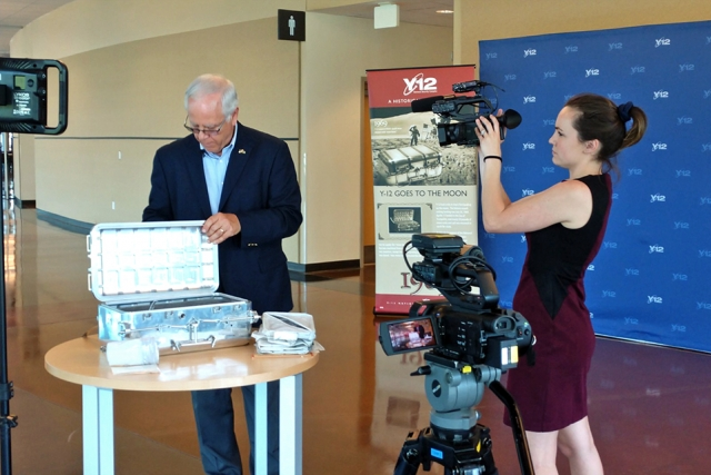 Paul Wasilko shows Emily DeVoe of WBIR one of the moon boxes built at Y-12 for the Apollo missions.
