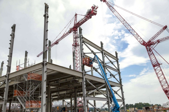 Ironworkers install steel on the second floor of the Salvage and Accountability Building at the Uranium Processing Facility.