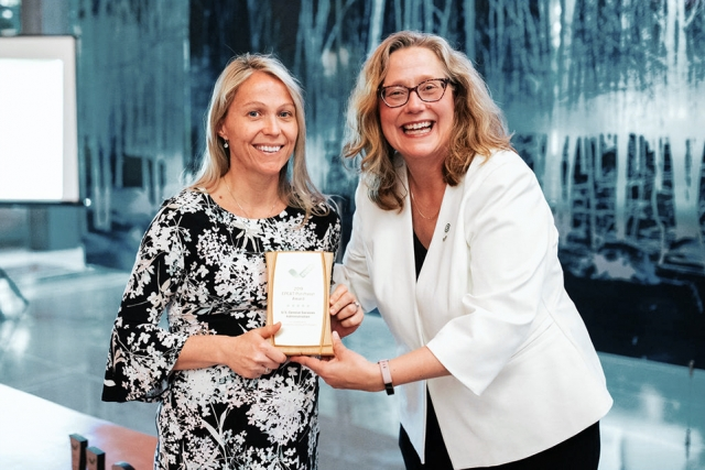 Consolidated Nuclear Security, LLC's Sustainable Acquisition Program Manager Sherith Hudson accepts the EPEAT award from Nancy Gillis, CEO of the Green Electronics Council.