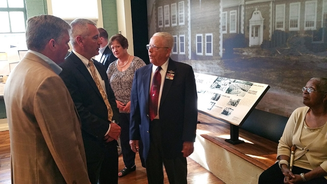 Y-12 Deputy Site Manager Gene Sievers talks with Tuskegee Airman Lt. Col. George Hardy at Green McAdoo Cultural Center.