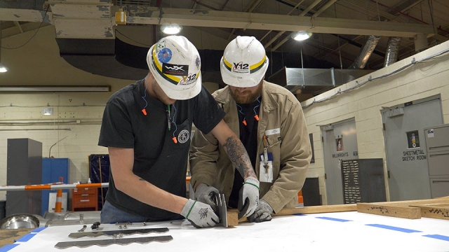 Construction employees create stainless steel rake blades to be used at Oak Ridge's Friendship Bell Pavilion.