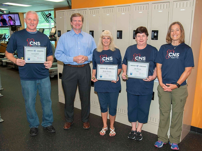 Y-12 Site Manager Bill Tindal (second left) and Karen Lacy (right), CNS wellness coordinator and Active for Life program co-director, congratulate members of CNS's winning Active for Life challenge team.