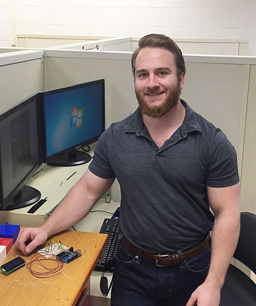 Veteran Chris Caserta works on an Arduino (an open-source prototyping platform used for creating interactive electronic objects) for his senior design course. Caserta, who is participating in the CNS Veterans Program, graduates in December with his bachelor's degree in mechanical engineering.