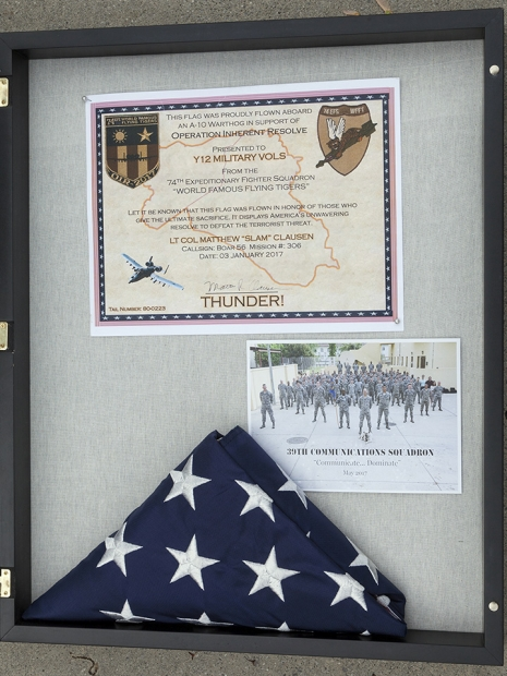 The certificate, photograph and flag are displayed in the group's area in Jack Case Center.