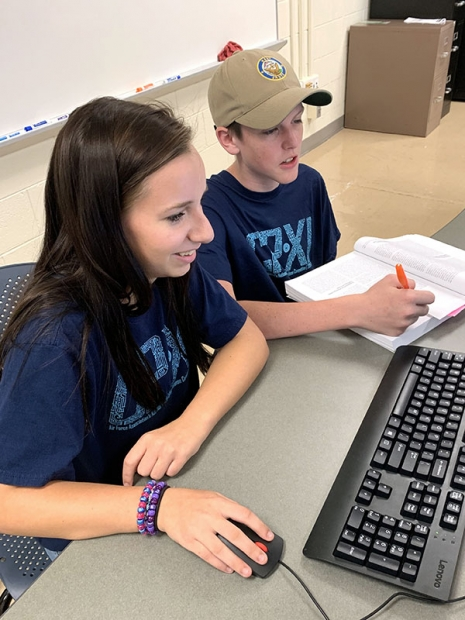 Oak Ridge High School students Elizabeth and Thomas work together on a training scenario to secure a company's operating system.